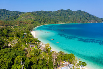 Foto op Aluminium Nieuw Zeeland Aerial drone view of traditional fishing boats moored over a coral reef around a remote, green tropical island in the Mergui Archipelago