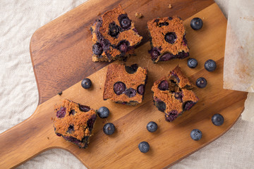Blueberry square bars on wooden board