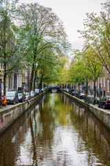 Amsterdam, Netherlands - September 27, 2011: One of the many bridges across Amsterdam canals. Amsterdam has more than 100 kilometres of canals, about 90 islands and 1,500 bridges.
