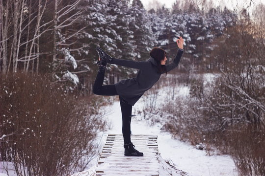 Winter forest yoga. Natarajasana - Lord of the Dance Pose. (shot on retro lens)