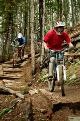 Bikers racing in forest Downhill mountain bike rally