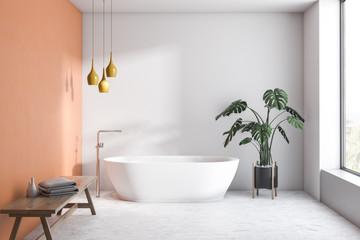 White and orange bathroom with white tub