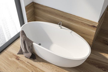 Top view of white and wooden bathroom