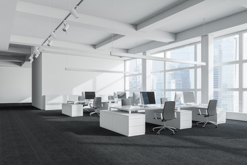 White open space office with columns