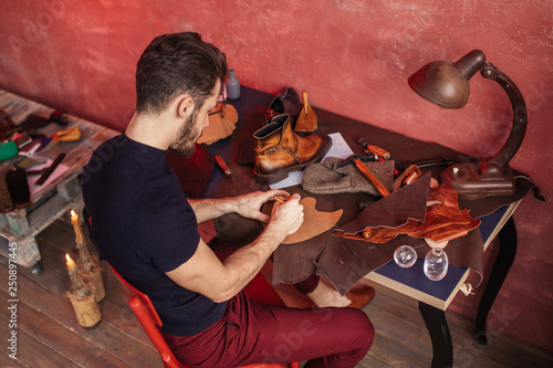 special method of making shoes  top angle view  man taking part in a
