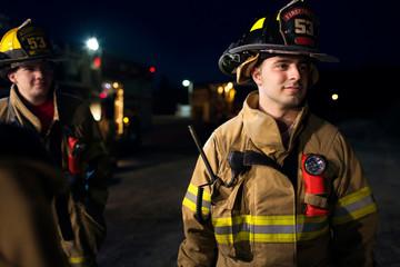 portrait of firefighter in fire station garage