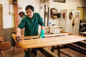 Furniture maker staining headboard