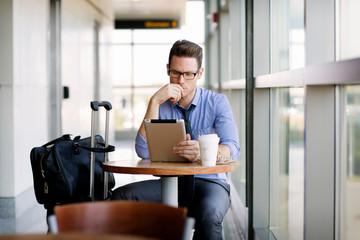 Businessman using digital tablet in cafe