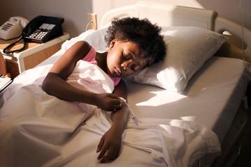 Girl (4-5) in hospital bed