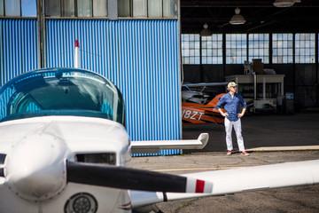 Man standing in one door to hangar