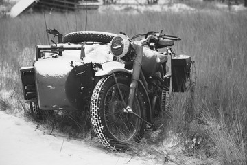 Fototapeta Old Tricar, Three-Wheeled Motorbike Of Wehrmacht, Armed Forces Of Germany Of World War II Time In Winter Forest