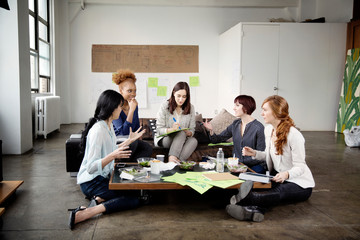 Group of businesswomen discussing project in office