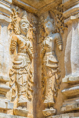Old stucco Buddha and angel figures on the outside of the Maha Chedi of Wat Chet Yot (Wat Jed Yod) or Wat Photharam Maha Vihara, the public Buddhist temple. Located in Chiang Mai, Thailand.