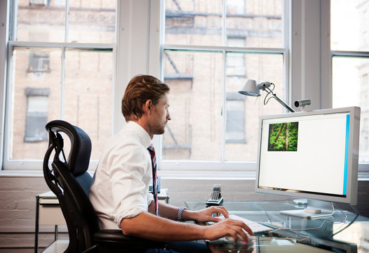 Businessman working at desk in office