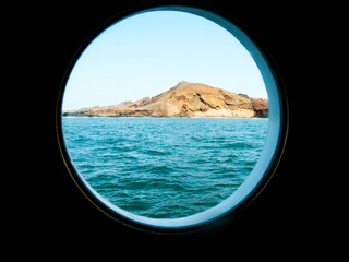View of Galapagos Islands seen through porthole