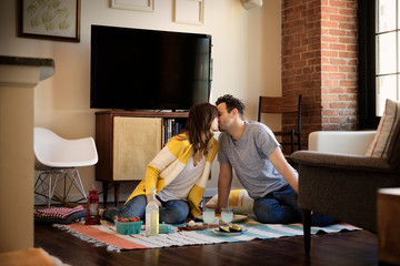Mid adult couple kissing in living room
