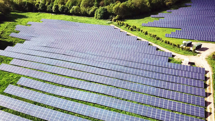 aerial view of solar panels in solar farm in beautiful nature