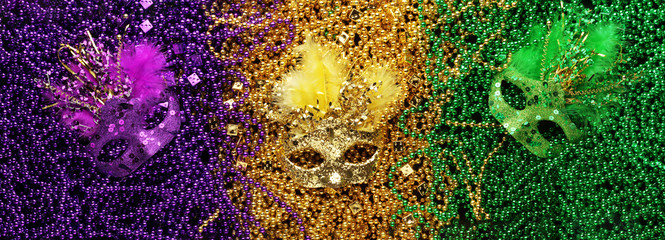 Purple, Gold, and Green Mardi Gras beads and masks background Wall mural