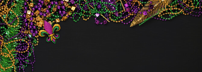 Purple, Gold, and Green Mardi Gras beads and decorations background Wall mural