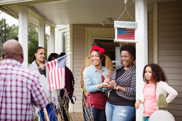 Family members with girl joking together on porch