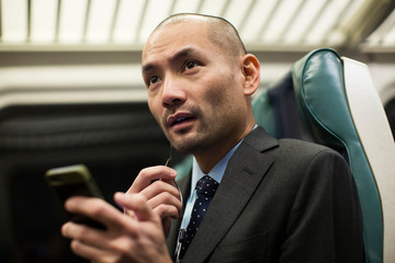 Man with mobile phone in train
