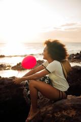 Teenage girl (16-17) laughing on beach