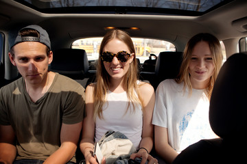 Young people on back seat