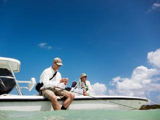 Men fishing on boat