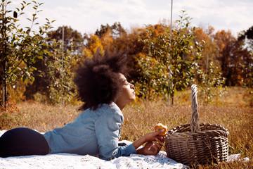 Woman lying on picnic blanket