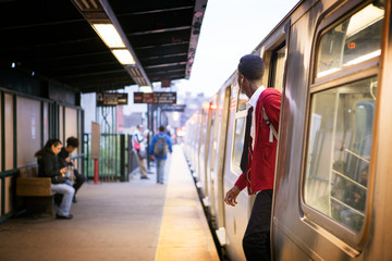 Teenage boy (14-15) getting out of train