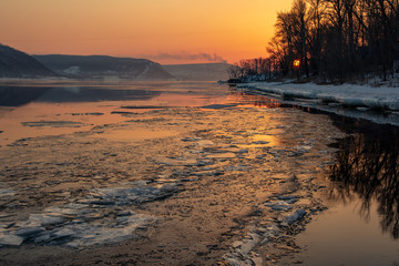 Melting ice on the river. Spring. Sunset on the Volga River