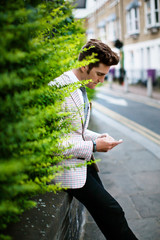 Well-dressed man texting