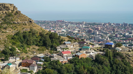 View of the north-eastern part of the city of Makhachkala - the capital of the Republic of Dagestan. On the left, Tarki-tau mountain is visible, in the foreground - Chagar aul