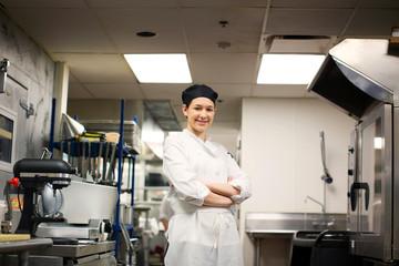 Female baker standing in professional baking kitchen
