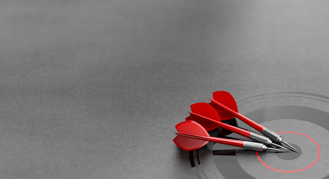 Three darts and business target background and copyspace on the left. Marketing and advertising concept.