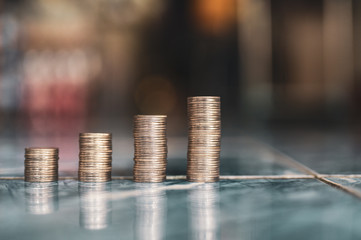 step of coins stacks, money, saving and investment or family planning concept.