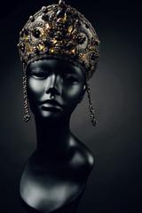 Mannequin head in creative metallic kokoshnick with skulls