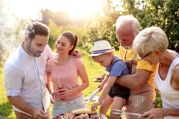 Happy family having barbecue