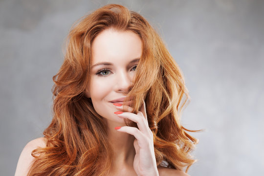 Portrait of young beautiful red-haired woman Caucasian type