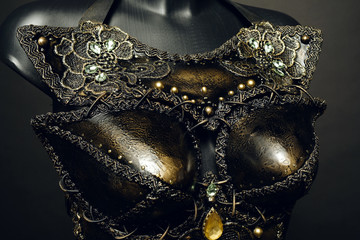 Gorgeous golden corset with precious stones