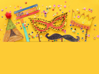 Purim celebration concept (jewish carnival holiday). Traditional symbols shapes cutted from paper