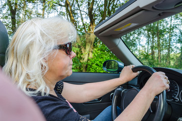Woman with blond hair in convertible