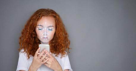 Woman with smartphone using face ID recognition system