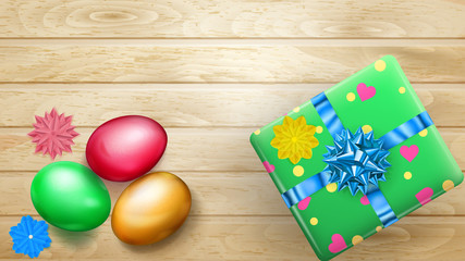 Realistic colored Easter eggs and beautiful gift box with bow on wooden planks