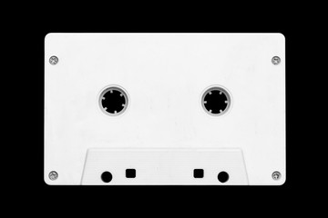 White cassette tape isolated on black. Old fashioned music play technology background.
