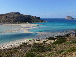Famous lagoon of Balos beach with white sand and exotic blue and turquoise waters on Crete island, Greece