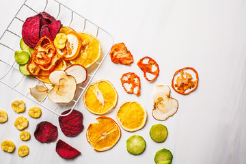 Dried vegetables and fruits on a white background, top view.