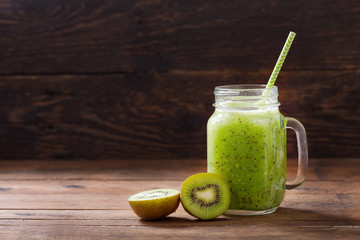 glass jar of kiwi juice or smoothie with fresh fruits