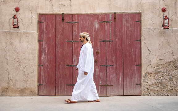 Arab Man walking in old Al Seef area of Dubai