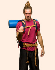 Hiker man with mountain backpacker inviting to come with hand. Happy that you came on isolated background